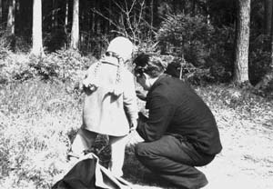 Svetlana and her father picking the first mushrooms